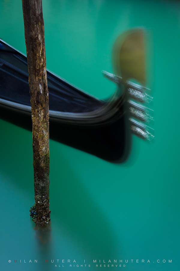 Long exposure of a gondola, tied to a pole. The waters were particularly green after a long rain and the color was further enhanced by circular polarizer.