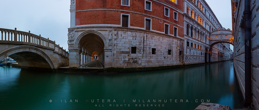 "Taken on a rainy March Morning, this panaorama depicts Ponte della Paglia on the left, the Doge's palace in the middle and Ponte dei Sospiri - Bridge of Sighs on the Right. This view was inspired by very similar photo of Italian photographer Paolo de Faveri. There are some subtle differences. The archway of Doge's palace is visible and if you're lucky, you can even catch a glimpse of ""The Doge's Ghost"" walking under it."