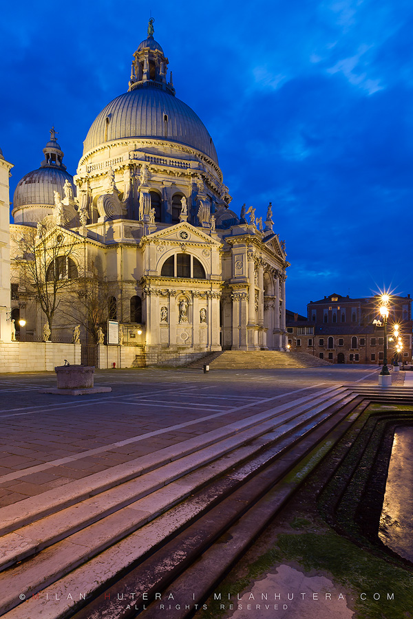A late, cloudy March evening on the canal steps leading to Santa Maria della Salute, one of the most famous and most beautiful churches in Venice.