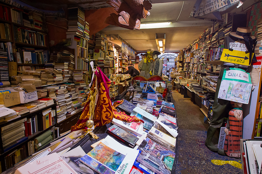 The famous Venetian bookstore with gondola serving as a bookshelf.