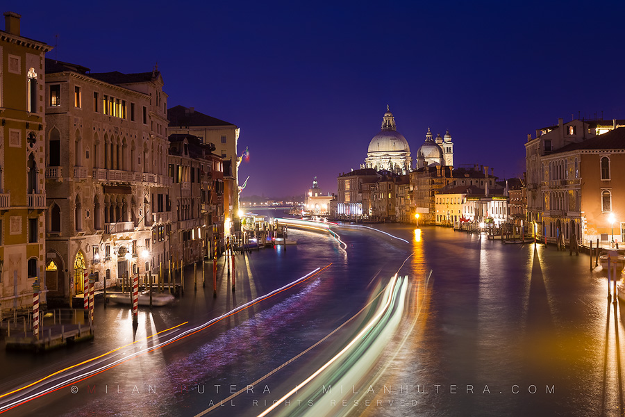 "The famous view of Gran Canal from Ponte dell' Accademia is captivating any time of day. But I feel the most interesting is just after the sunset during the ""rush hour"". The last light of the day is still visible in the sky, the city ligths come alive and the boats create those fantastic long streaks of light."