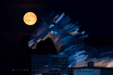 Moon rises above the impressive metal statue of a horse during the evening session of Summer Masters in Samorin, Slovakia.