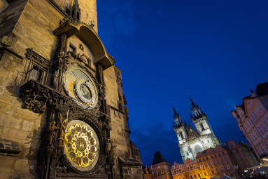 The famous Astronomical Clock on Old Town Square in Prague during the twilight hour. This marvel of engineering was constructed in 1410 and it's the oldest astronomical clock that is still operational. It shows 21 different astronomic functions.