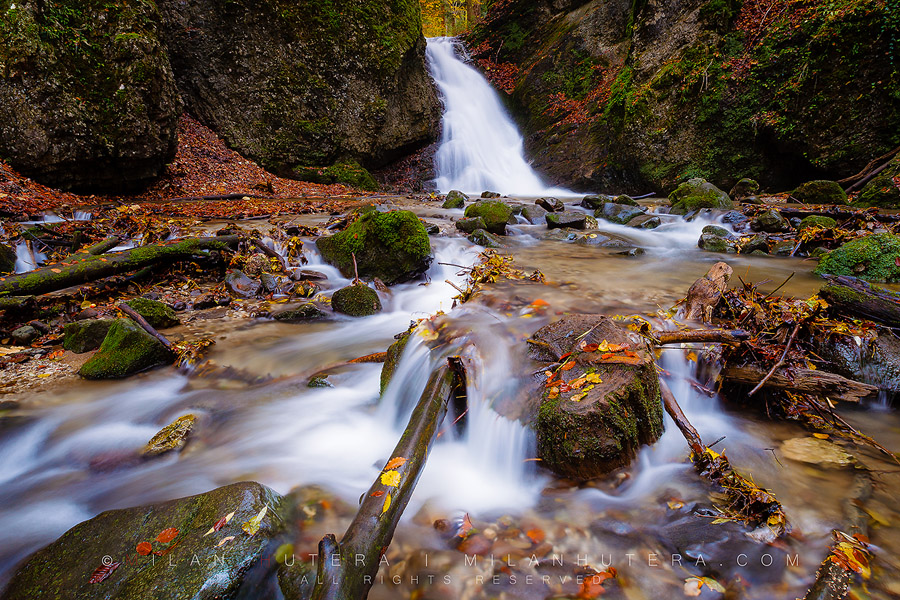 A colorful autumn at Kraliky waterfall in Central Slovakia. This small gorge is located just outside Banska Bystrica with the 7 meter tall waterfall at its end. The amount of water running throught the waterfall was impressive on this overcast autumn day.