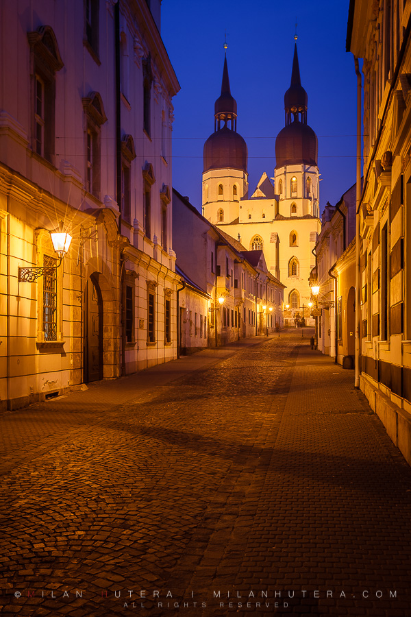 """An Evening view of the Basilica of Saint Nicolas. Built between 1380 - 1421 AD, it's north tower houses one of the largest bells in Europe. Because of large number of churches,Trnava is nicknamed """"Little Rome""""."""
