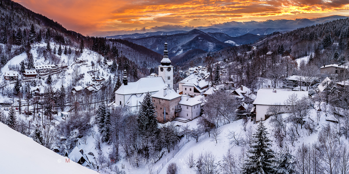 An incredible display of sunset colors at the famous overlook of Spania Dolina. The entire valley received a decent snowfall the very same day. Spania Dolina is a famous mining village in Central Slovakia. The hill in the middle of the village houses the Church of Transfiguration.