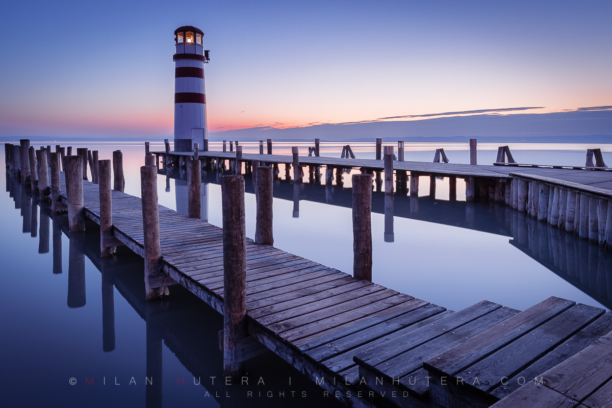 The very calm and very cloudless twilight hour at Podersdorf am See Lighthouse, Austria. Podersdorf Lighthouse is located on the shore of Neusiedler See, a large lake on Austrian-Hungarian Border.