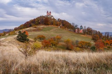 A colorful autumn evening at restored Banska Stiavnica Calvary - one of the largest complexes of its kind in Europe. It was built between 1744 and 1751. Located on the Scharffenberg hill in the eastern part of the city a total number of 22 chapels and churches depict the final hours of Jesus and the seven pains of his mother Mary. In 2007 it was listed as one of 100 most endangered cultural sites. Since then, the restoration effort has been underway.