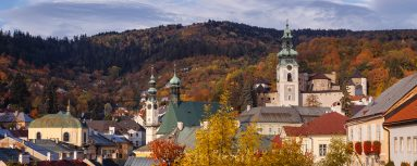 A morning panorama of Banska Stiavnica, a very old mining town located in Central Slovakia and a part of UNESCO World Heritage Site. The displayed town landmarks are: Old Castle (Right), The Church of Saint Catherine (Center) and Evangelical Temple (Left)