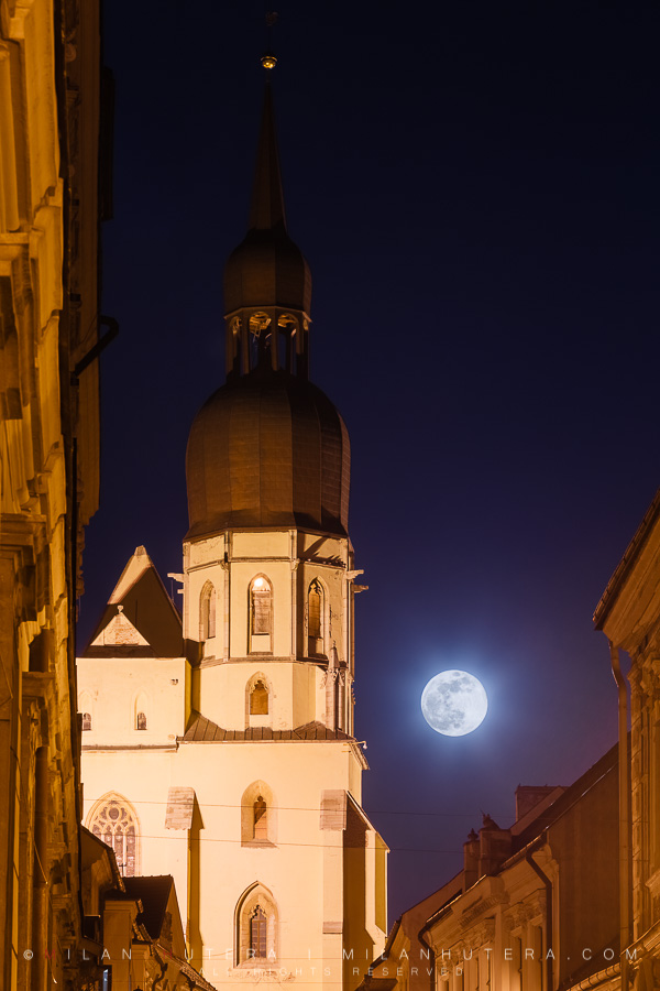 "A ""Super Snow Moon"" rises next to the tower of Basilica of Saint Nicolas in Trnava, Slovakia on the evening of February 19th, 2019."