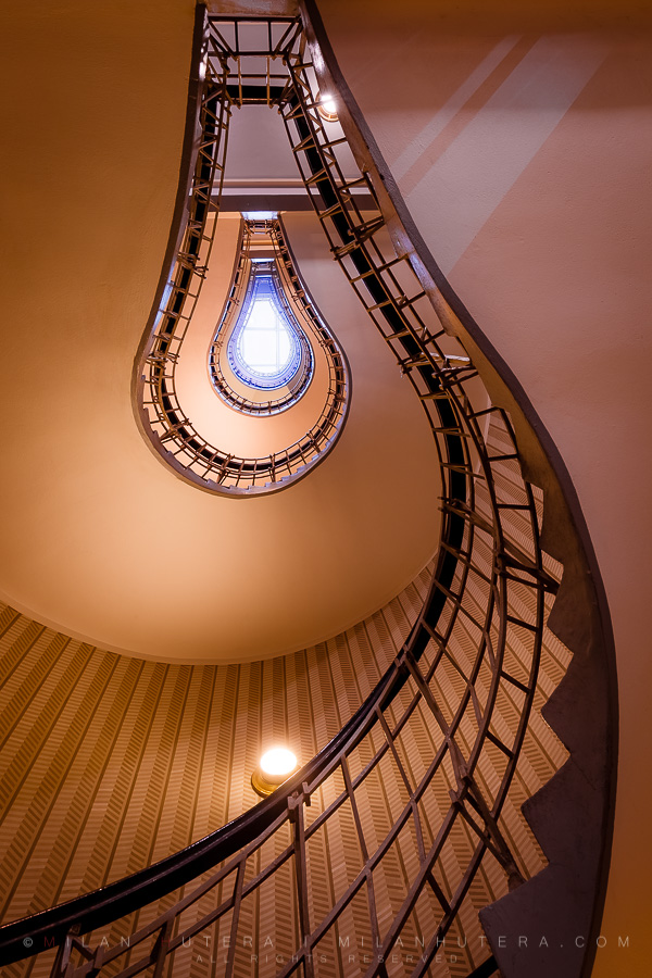 The house of Black Madonna is a prime example of cubist architecture, designed by Josef Gočár in 1911. The spiral staircase is one of the many cubist treasures hidden both inside and outside of the building. When looked at from the proper angle, it indeed looks like an incandescent light bulb.